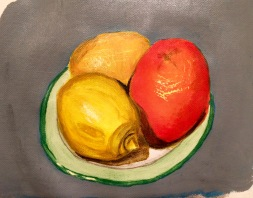 Paining of an orange and two lemons on a plate in acrylic paints on canvas paper.